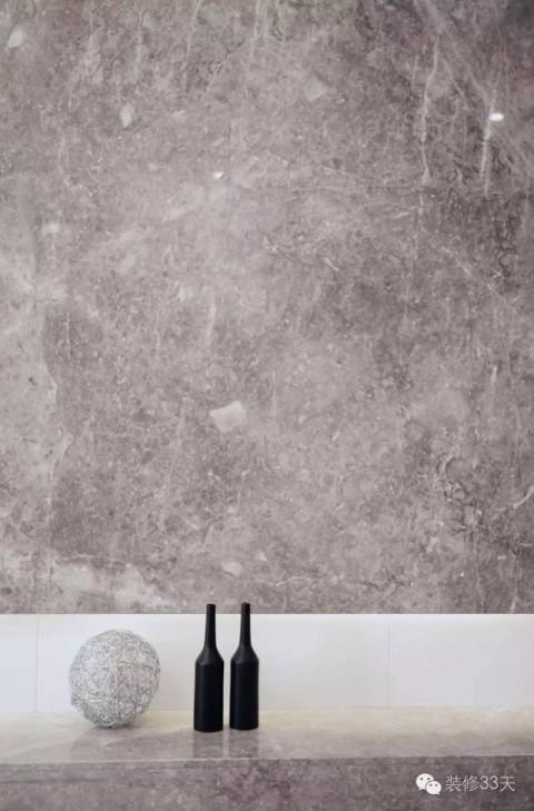 关内容 ▲ 电视背景墙是以灰色大理石造型的,底部