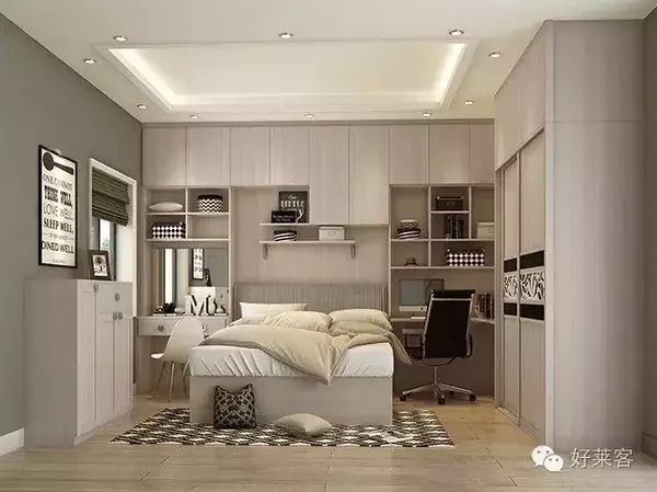 床的后方为整墙式储物柜,划出梳妆台与书房,再在书桌连接处设移门衣柜